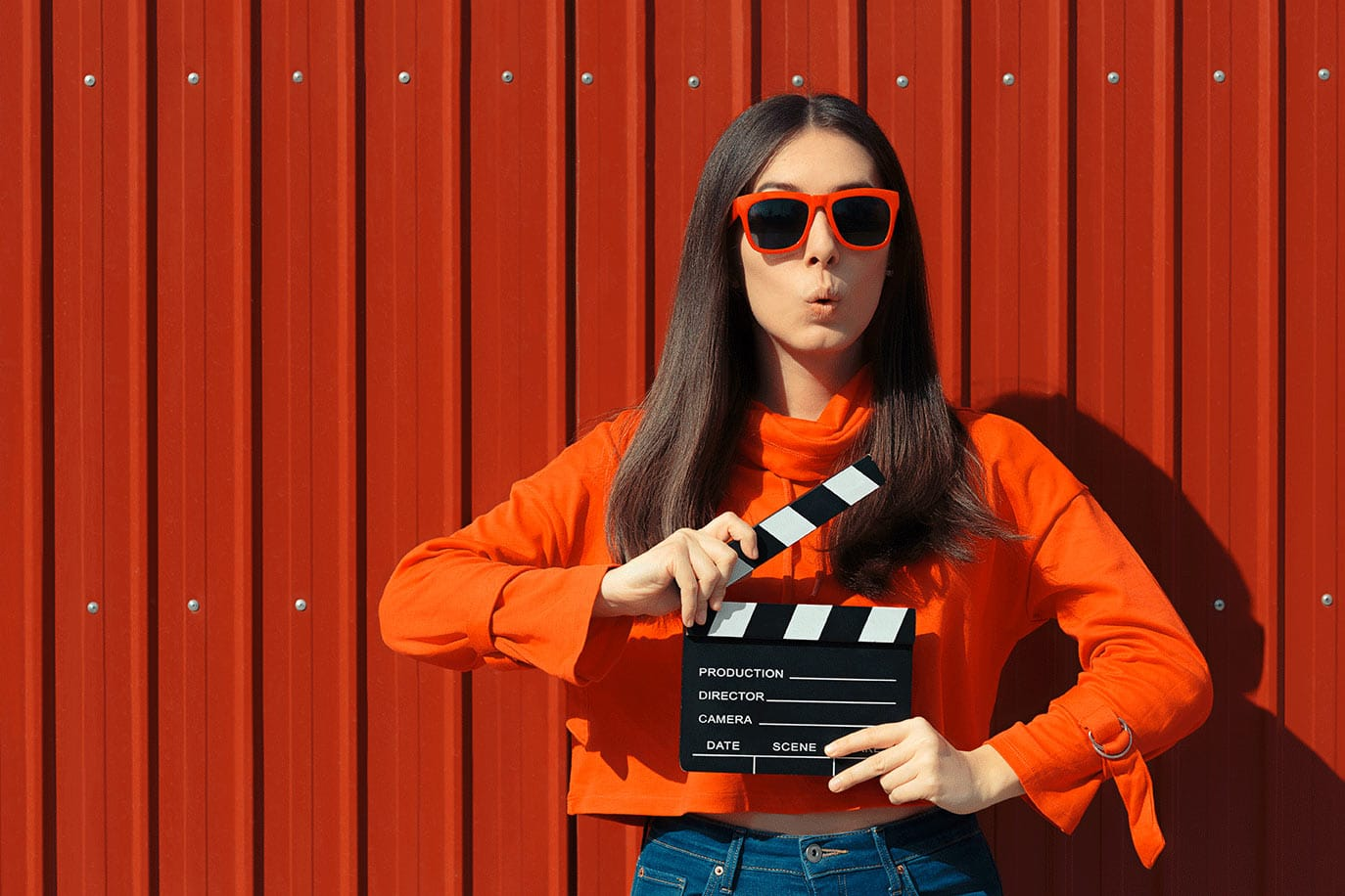 girl with movie clapboard